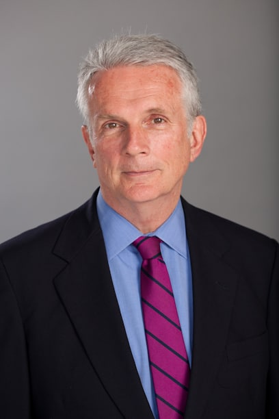 B. John Dill, CRE, FRICS